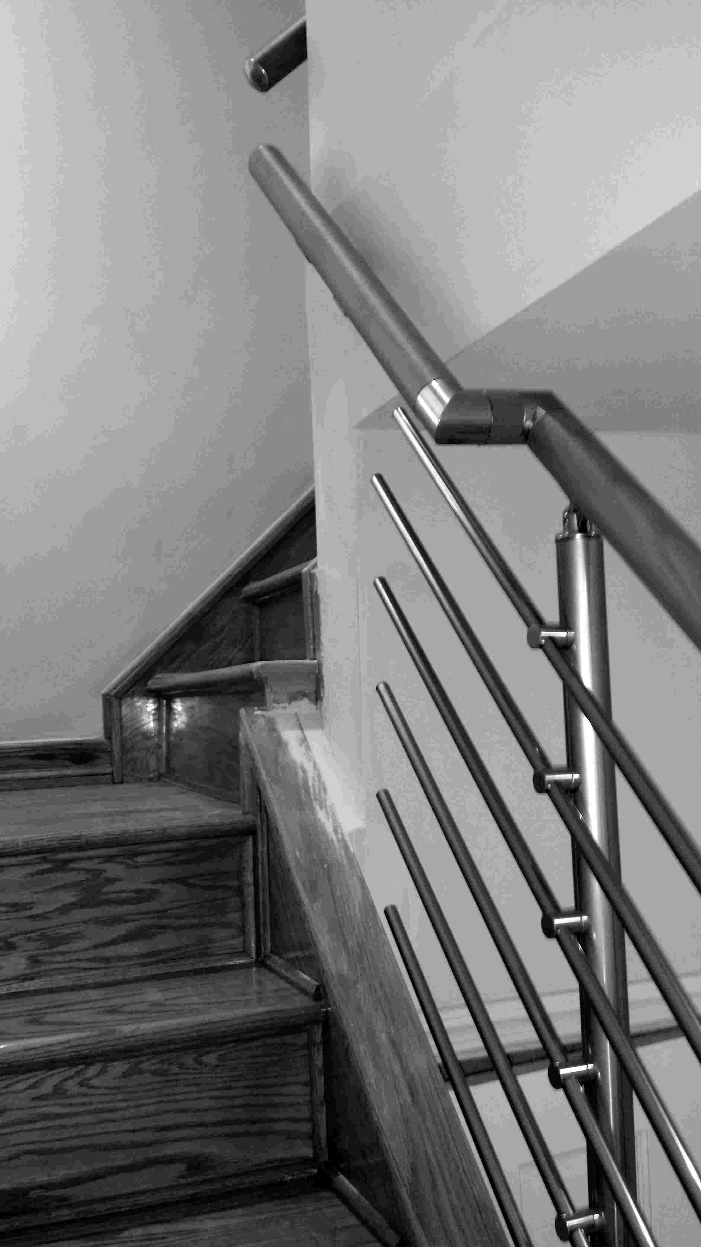 Interior modern narrow staircase railing system